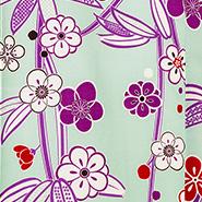 黄緑ベースに紫の花をあしらった生地