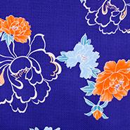 青色ベースにオレンジの花をあしらった生地